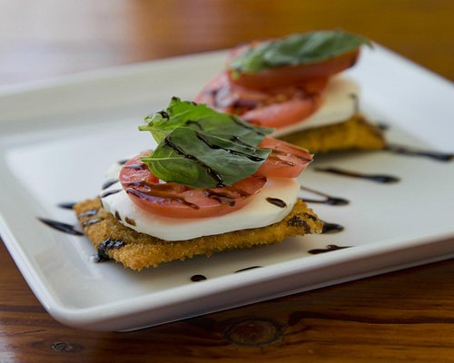 Fried Colorado-made Ravioli with Mozz, Basil, Tomato and Balsamic Reduction