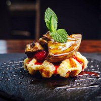 Our newest appetizer is fresh Belgian waffles topped with fois gras with a drizzle of berries.