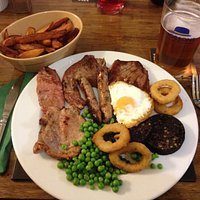 Full mixed grill with local meats cooked med/rare with home cut chips. Perfection on a plate wit