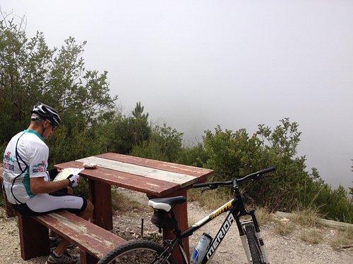 snack break on the cliff in the fog