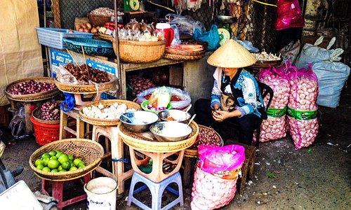 Vendor awaits customers in markets