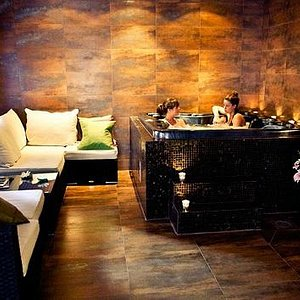 Realx after your treatment in our warm jacuzzi
