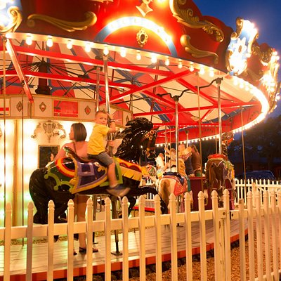 The vintage carousel at Davenport Park as seen at night.