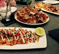 The Szechuan Calamari and The Truffled YOLO Chips