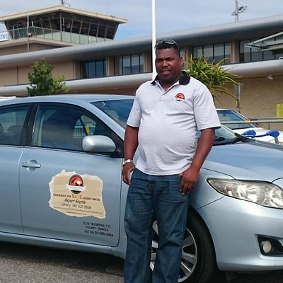 The terrific operator Johnny and one of his vehicles at George Airport