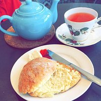 Pink Lemonade Tea and a butter scone with devon cream and preserves