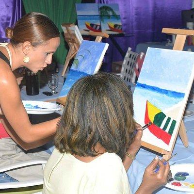 Artist, Liana,helping a student