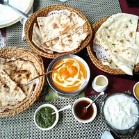 Tandoori Roti types, butter Chicken in the middle