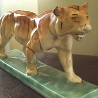 old ceramic tiger statue- now cleaned and on my mantle!