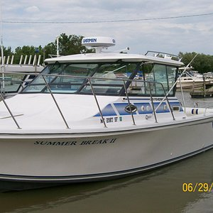 Fish Lake Erie on a clean comfortable 30 ft Baha Fisherman
