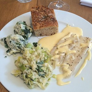 Sole Fillets, Spinach & Ricotta Gnochii, with creamed Leeks and Hollandiase sauce