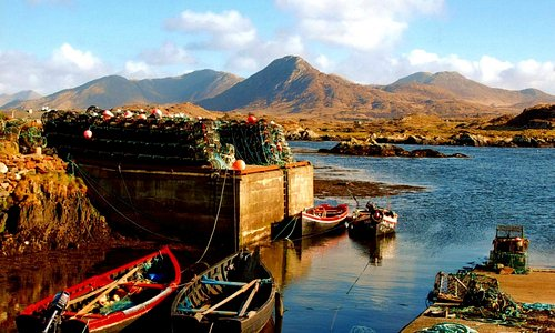 Lobster pots on the Derryinver pier with 12 Bens mountain range