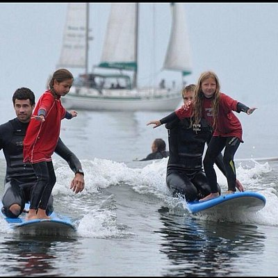 Tandem surfing with some stoked campers!!