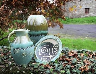 green range of stoneware pottery on our front wall
