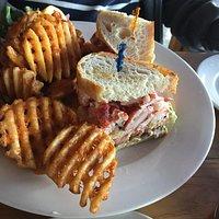 Lobster club sandwich with waffle fries