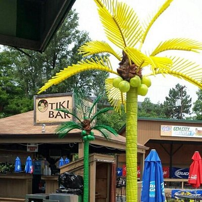 Outdoor tiki bar and sand volleyball courts .