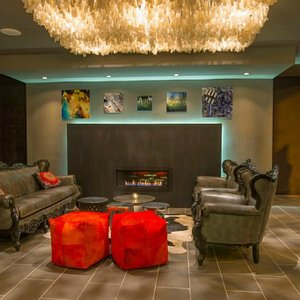 The Playhouse lobby has a warm, inviting feel with seating and a full-service bar.