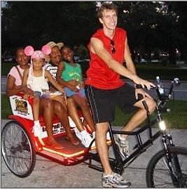Families Enjoy pedicab rides and tours on International Drive in Orlando, Florida.