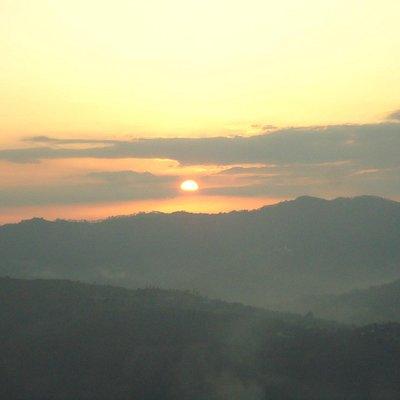 The setting sun amid mountains.
