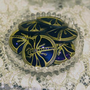 one of 6 dragon fly button styles