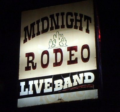 Street sign, Midnight Rodeo bar