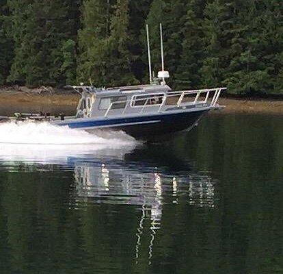 "Neil and Kristi aboard ""Wholly Roller"" ready to go fishing on Haida Gwaii"