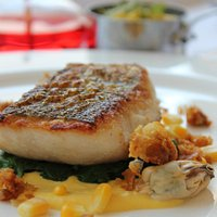 West Country Hake served with Mussel, Sweetcorn and Chicken Skin