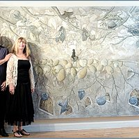 The artists in front of one of the large paintings.