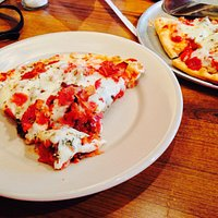 """Slice of 10"""" Slaughterhouse Five Speciality Pizza"""