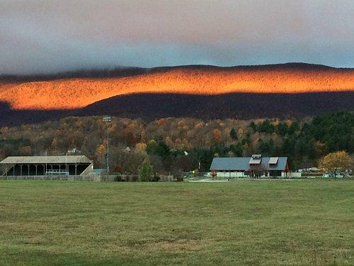 Sunrise lighting up Mount Equinox, from Dana Thompson Park
