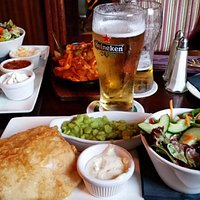 Fish & chips and Mexican Chicken Fajita with 2 pints. Very good, large servings.