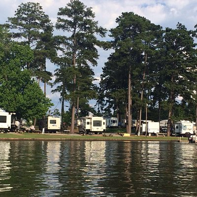 View of camping area near boat dock from water