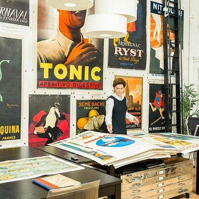 Karen Etingin, the owner of L'Affichiste, showing some of our vintage posters.