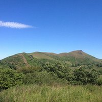 Caer Caradoc skyline from Cwms Farm upper valley. View from summit North East with Wrekin in bac