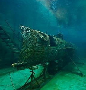 The Hunley, the world's first sucessful combat sub, sitting in her 75,000 gallon conservation ta