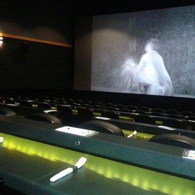 Illuminated dining while movie plays