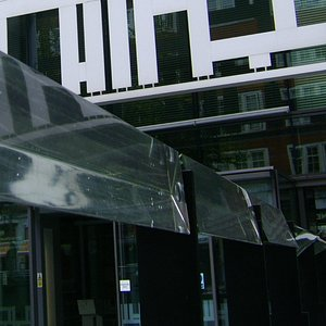 Large Prisms reflect the sun and the colored glass onto people and other surfaces.
