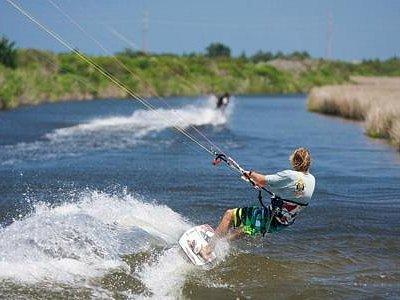 Kiteboarding behind REAL Watersports