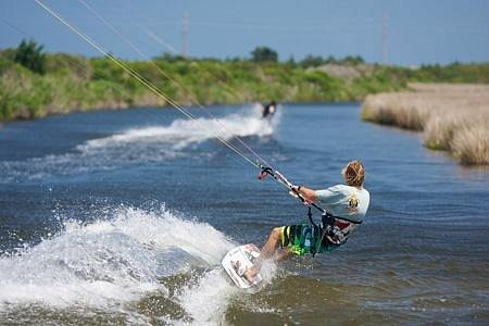 Kiteboarding behind REAL Watersports