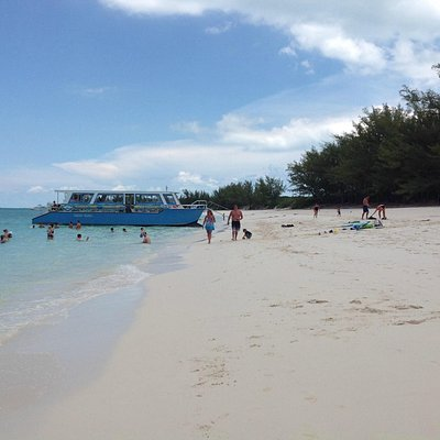 Travel to a tranquil lagoon beach after seeing the beautiful Nassau harbor.