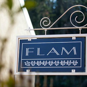 Flam's welcome sign