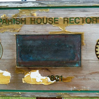 Rectory Sign that has been in the sun and weather