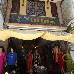 Storefront on a busy shopping street in Danang city.