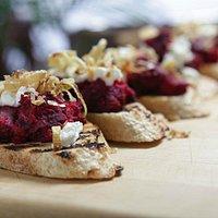 Roasted beet bruschetta with chevre and crispy leeks