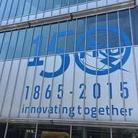 ITU building entrance and 150 year logo.  ICT Discovery on 2nd floor inside.