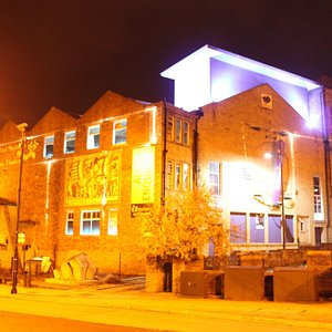 An exterior landscape shot of the Bradford Playhouse; illuminated in all of its glory.