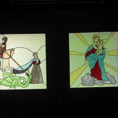 Stained glass, and obviously with St. George on the left.
