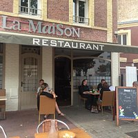 The front of the restaurant facing Rue Amiral Courbet.