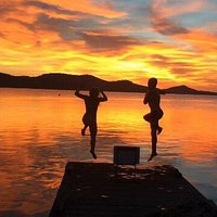 Jumping off the dock at sunset