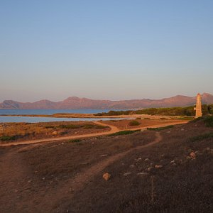 Sunset on the beach of Son Real, looking ENE.  In the background, Cap de Ferrutx, Puig de s'Agui